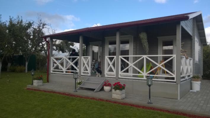Log Cabin with Fancy Veranda
